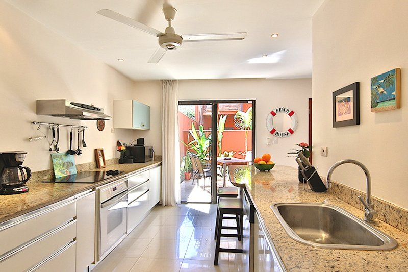 Kitchen with Walkout to Dining and Seating Area