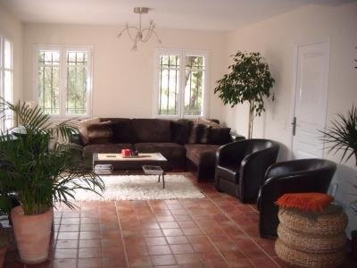 Bright comfortable living room area with exit to front terrace