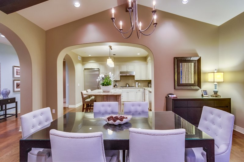 The dining room features a dining table for six.