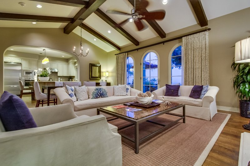 The living room includes french doors that open up the the patio space.