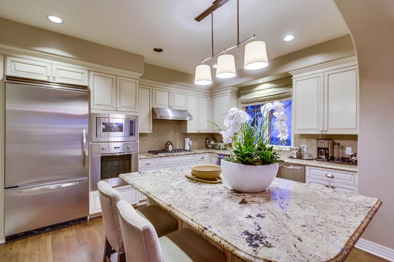 The large kitchen is a perfect gathering place for family and friends.