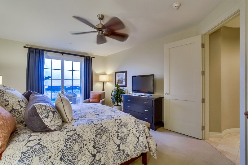 The master bedroom has large windows with views of the Pacific Ocean and Catalina Island.