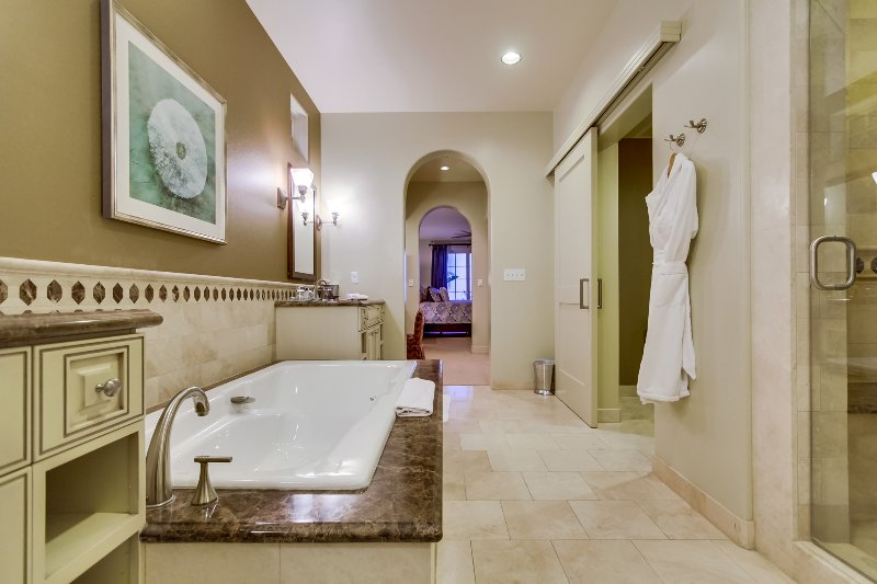 The deep soaking tub in the master bathroom.  Resort style bathrobes are available for guest use.