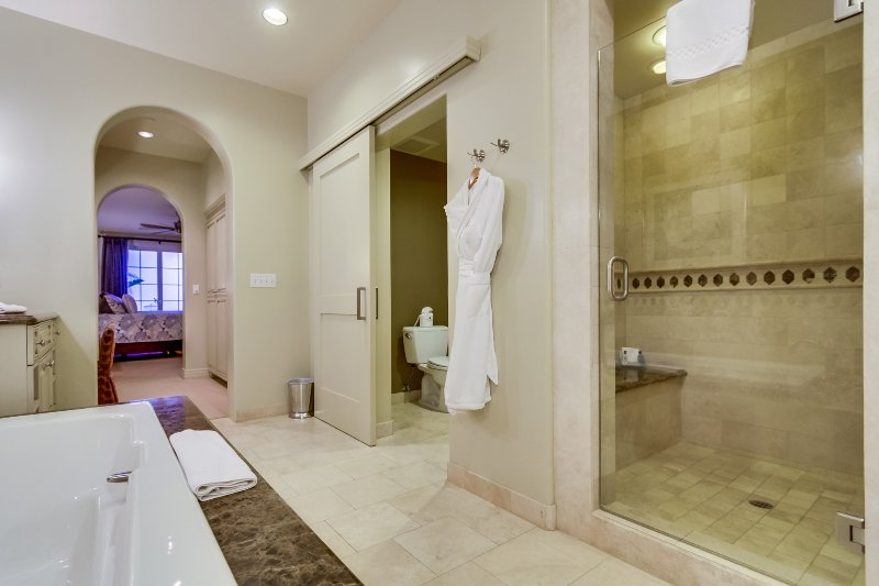 The master bathroom includes a large shower.