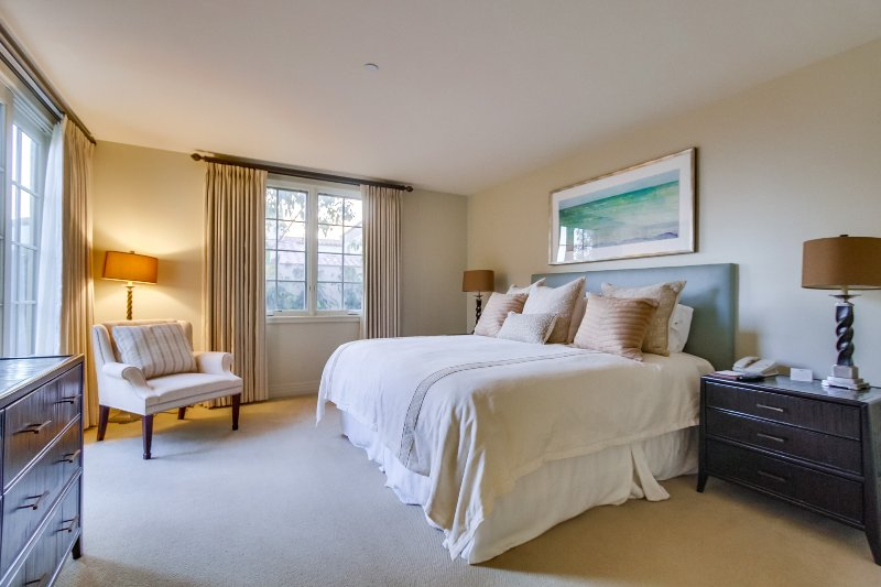 The second bedroom includes a comfortable king sized bed.