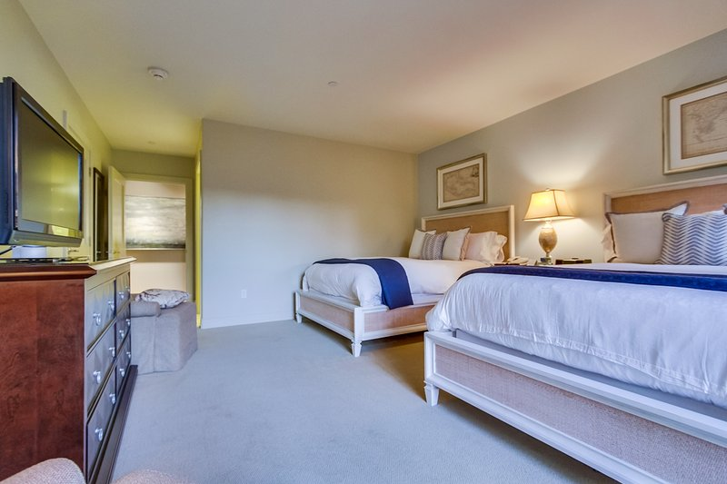 The third bedroom features 2 comfortable queen sized beds,