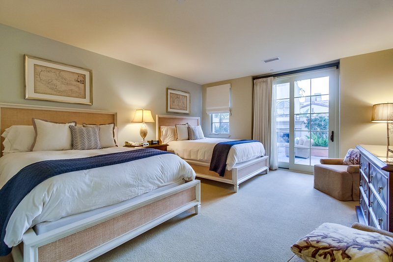 The third bedroom has large doors which open up to the private outdoor loggia.