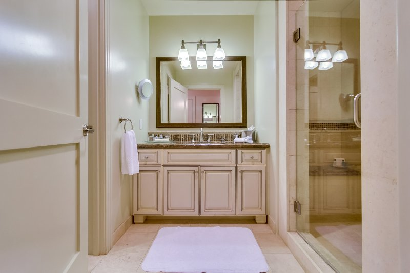 The second bathroom is immediately adjacent to the second bedroom, and has a large shower.