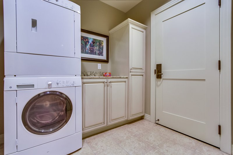 A full sized washer and dryer is located in the laundry room.