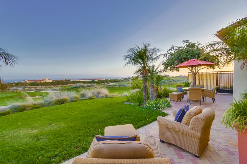 The patio at sunset overlooking the Golf Course and Pacific Ocean.