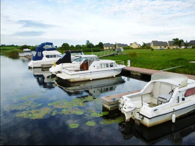 Boats moored at the marina adjacent to the properties
