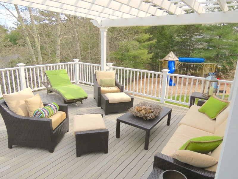 Large upscale home offers superb outdoor living space -- and play space for the kids.  Relax and watch them on the playscape just off the deck.