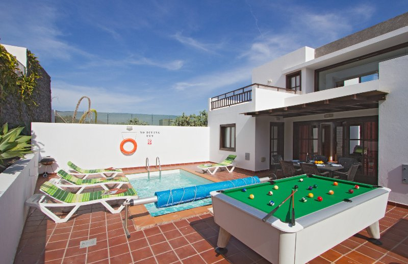 Private pool with terrace area and pool table
