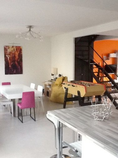 Large living room, modern, friendly, bright and giving side garden / terrace and courtyard