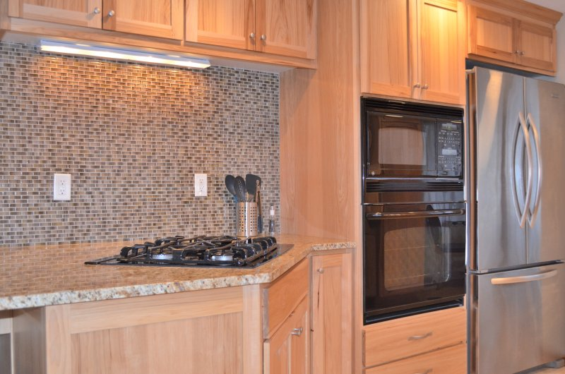 Top of the line appliances including gas cooktop