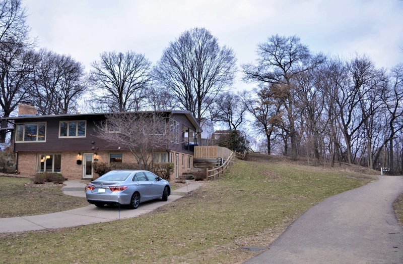 Beautiful wooded area with paved walking path adjacent to property