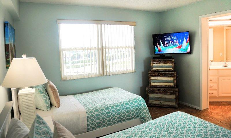 Guest bedroom has a walk in closet, 42' TV, Bluray player & bathroom