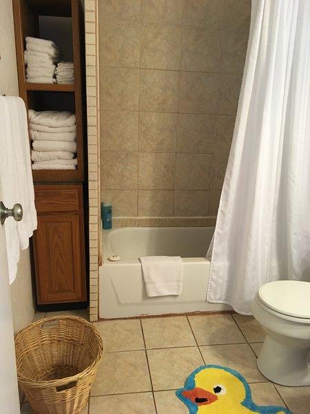 1st Bathroom with Beach towels, bathtub shower