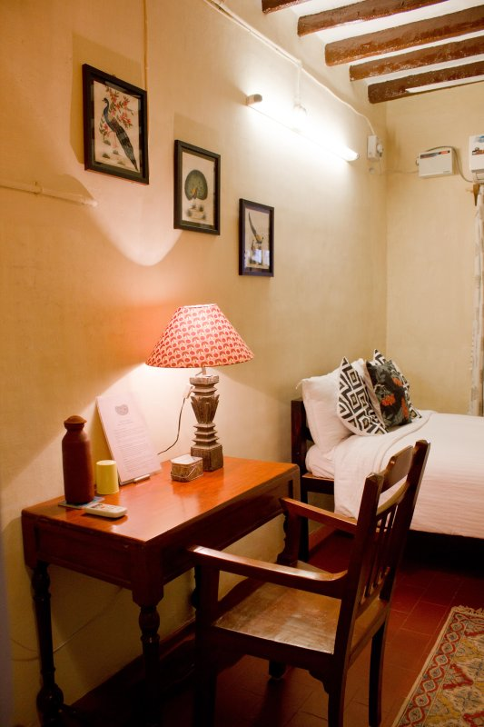 Tastefully furnished room with unattached bathroom