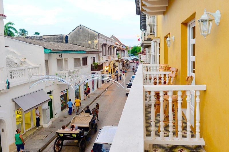 Balcony view along Calle Segunda de Badillo often includes of horse drawn carriages!