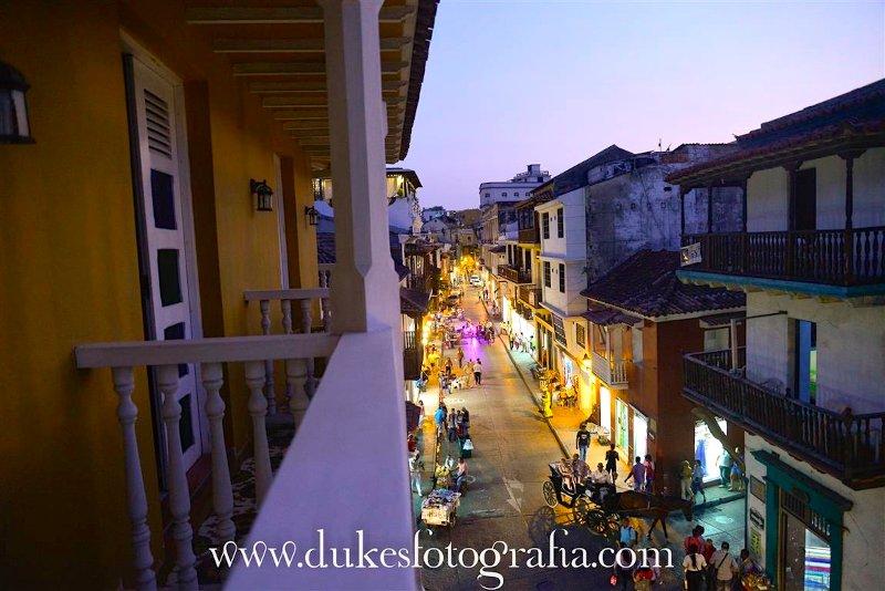 Evening balcony view to Calle Primera de Badillo with horse drawn carriage!
