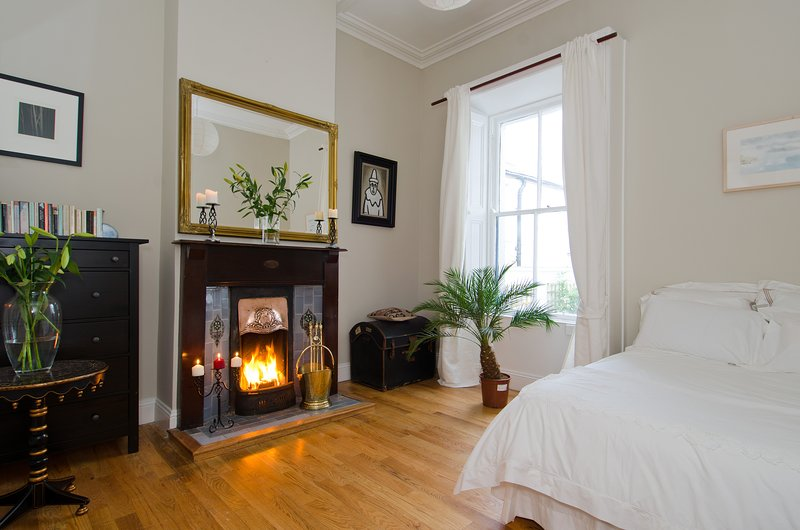 Large double bedroom with working fireplace