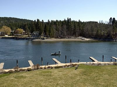 Stunning views from the patio! Swan mountains, swan river and Flathead lake. Hanging swing, rug and