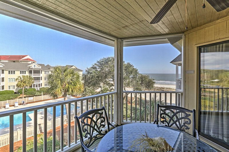 You'll love the view of the pool and ocean from the porch.