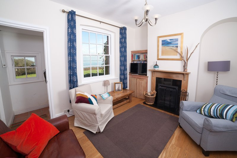 The living room in Sea View Cottage has stunning views of the sea