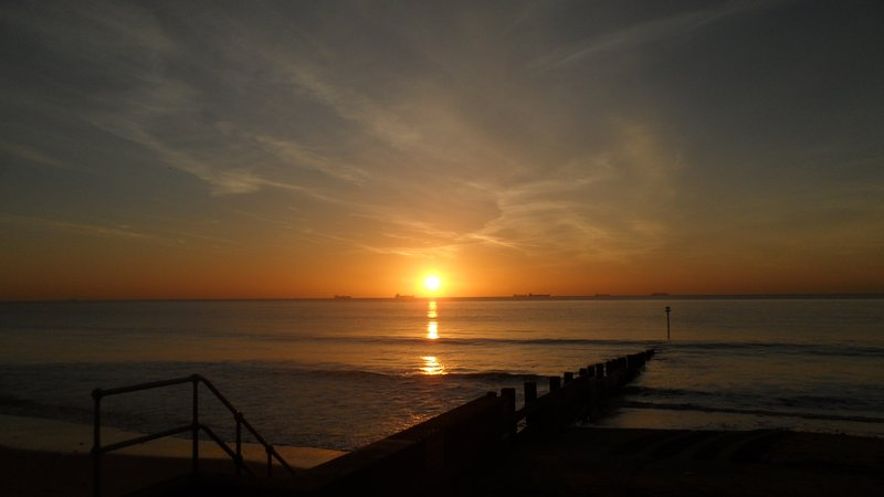 Sunrise over the container vessels in Sandown Bay - from Yaverland slipway.