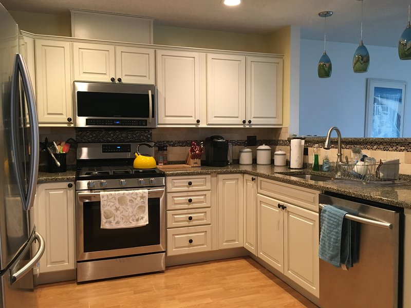 Our kitchen -- totally redone in 2016, with new gas stove, frig & dishwasher & everything you need!