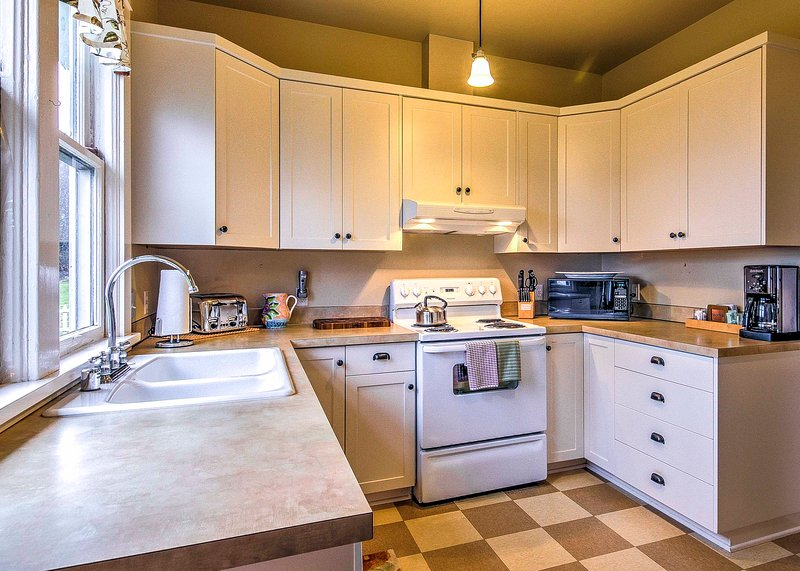 Prepare a home-cooked meal in the fully equipped kitchen.