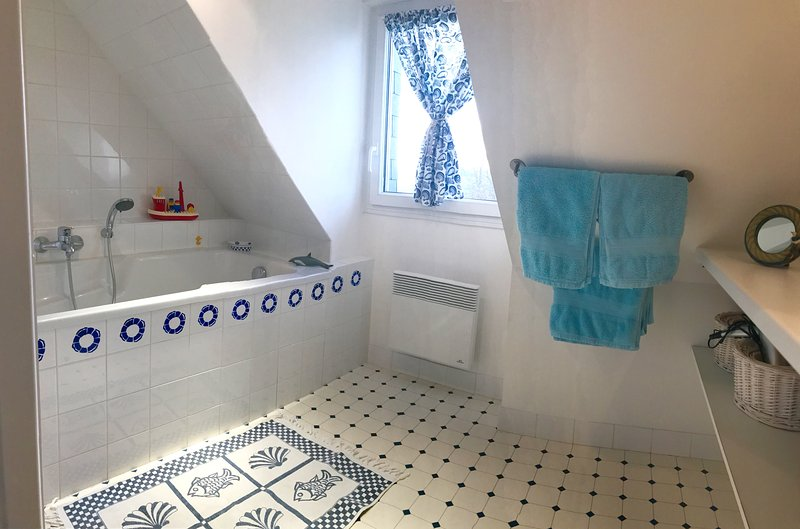 floor of the bathroom tub and sink