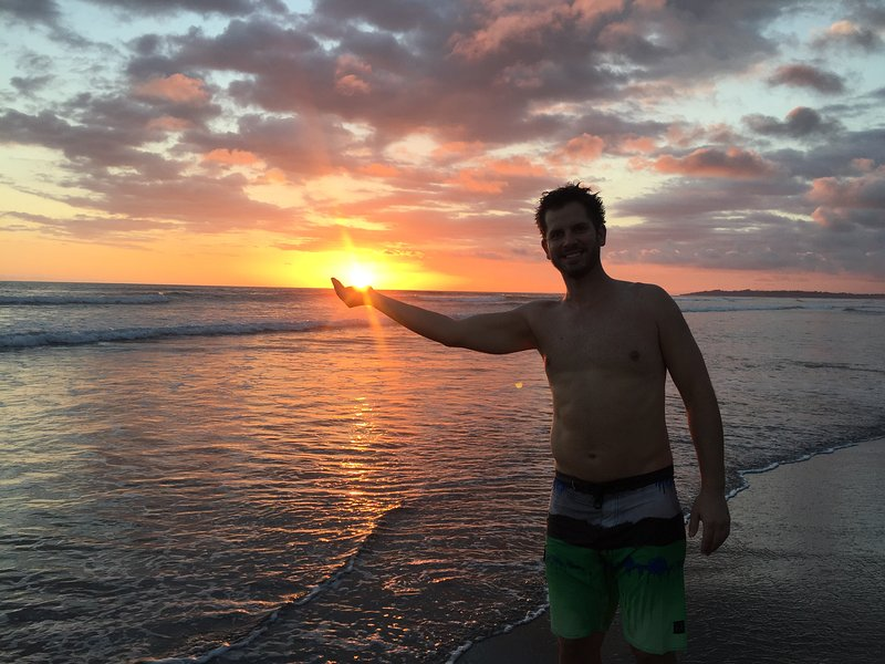 Life is best in board shorts . . . holding the sunset in your hand!
