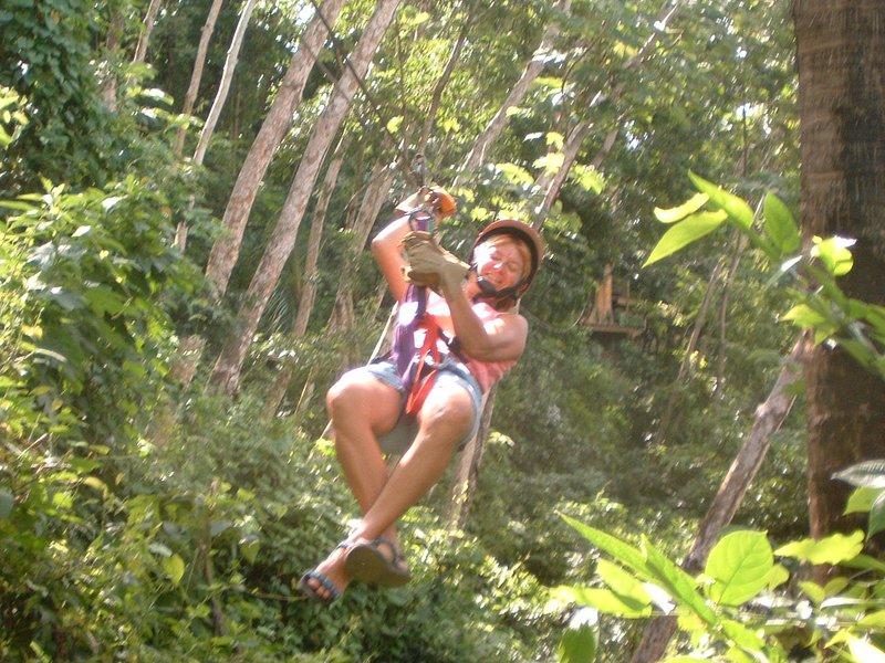 My friend Janna zip lining the jungle to the beach.