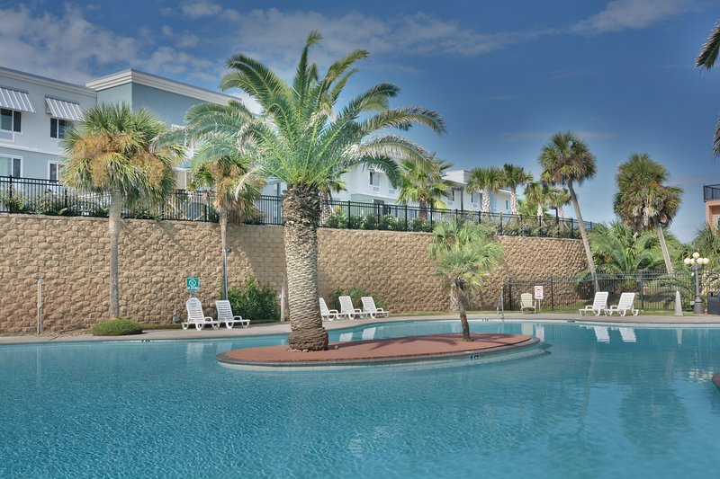 The resort pool has a swim around island