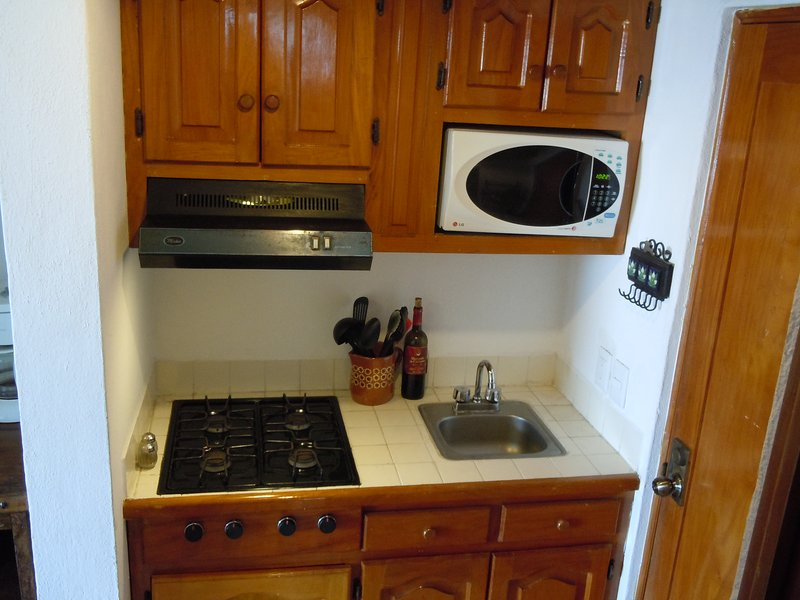 Kitchen with 4 burner gas stove, microwave; coffee maker--well-equipped.