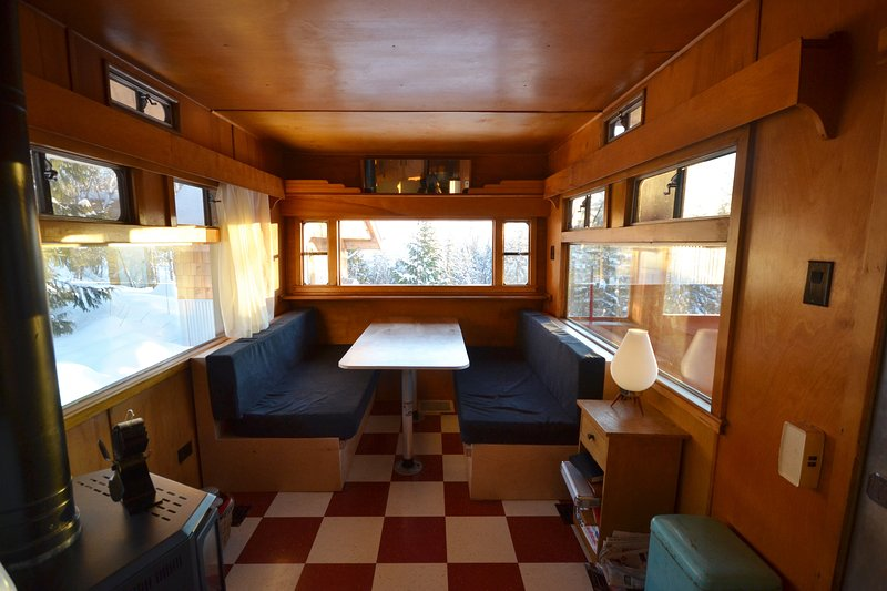 Dining area in the caravan folds into a queen sized bed.