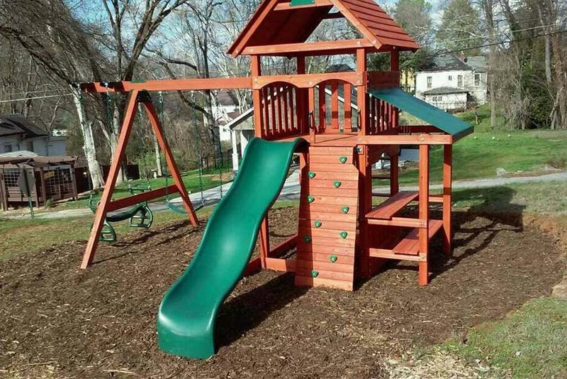 Play set for the kids.... swing, slide, glider, sitting area and climbing wall.