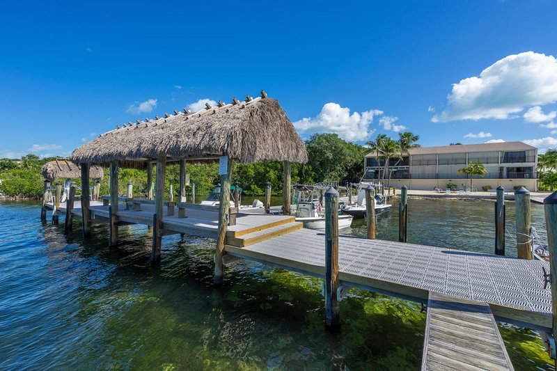 Our dock and view of our TH 'Mina Bay' from the water...
