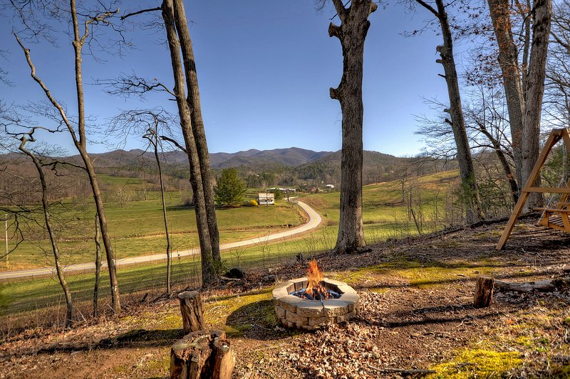 The fire pit calls guests to roast hotdogs or marshmallows on the open pit.