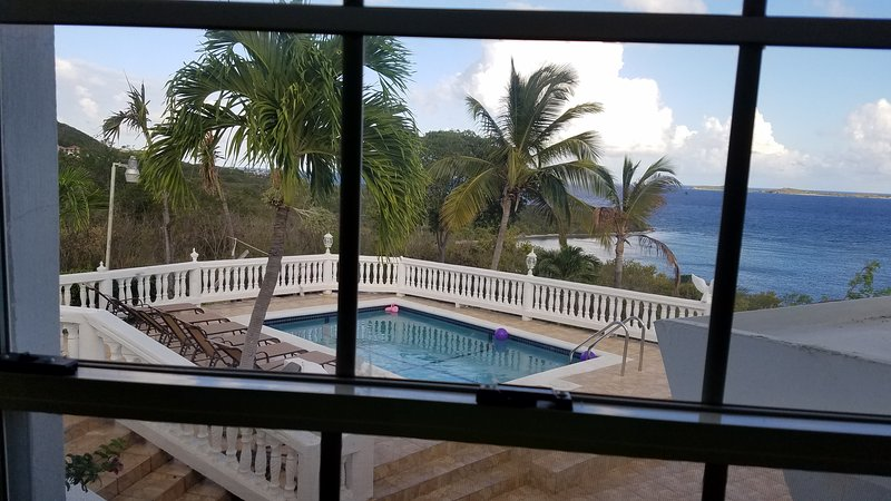Pool and Beach view from master bedroom window