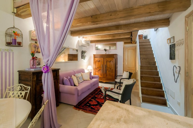 Attic Amethyst. The relaxing area, tv. The stairs to the second level