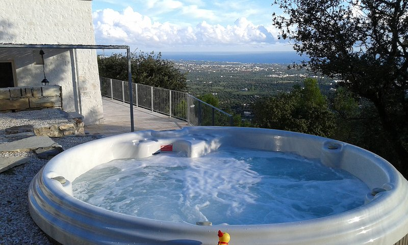 The heated spa bath with a view under the stars! It has space for 1-5 persons