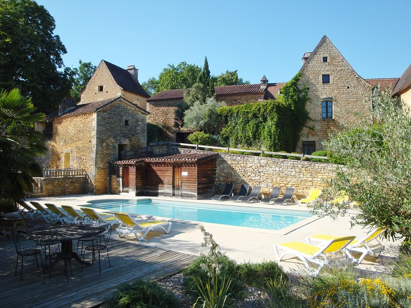 The cottage is located in the gable just above the pool