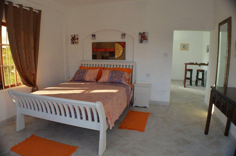 Frangipani Apartamento - El dormitorio