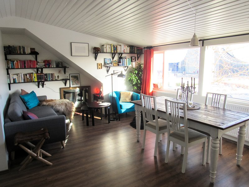 Living room has a view onto Reykjavík's major landmark and a volcanic mountain ridge in the distance