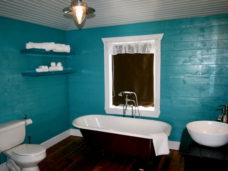 4 pc bathroom with authentic antique claw foot tub and seperate corner shower.