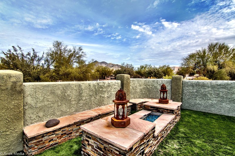 Gas fire pit with sit down bench. Great desert and mountain views.