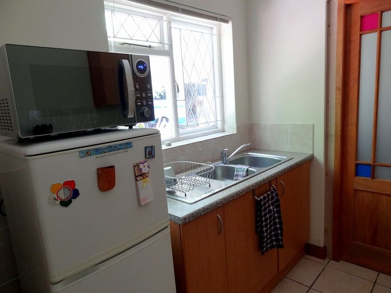 Fully equipped kitchen with fridge, microwave, 2 plate gas hob, kettle & toaster.
